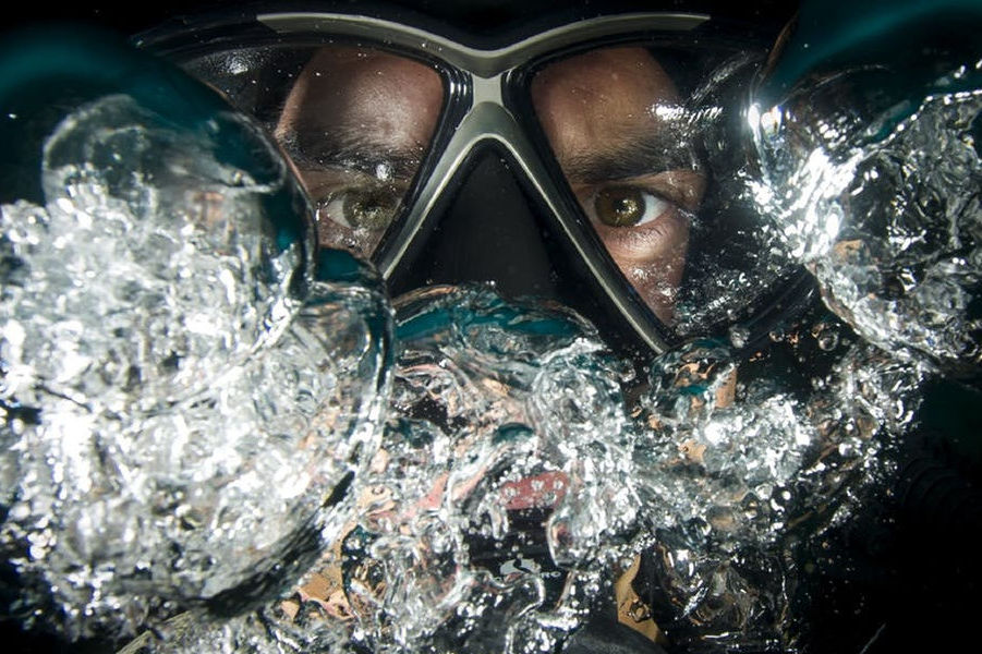 Scuba diver with diving mask underwater